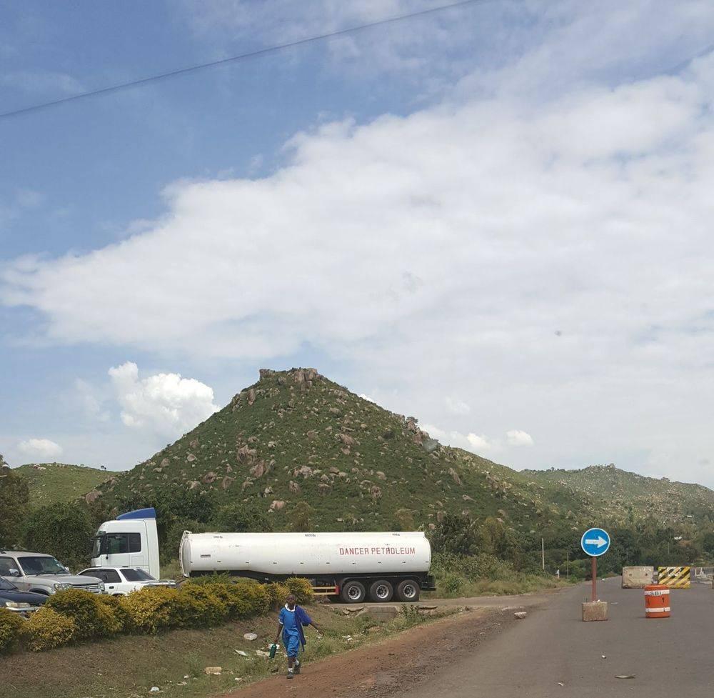 mountains outside kisumu kenya , tusker beer , kisumu lakeside restaurant , kisumu international airport kenya , british & far east traders , welcome to kenya , kenya africa