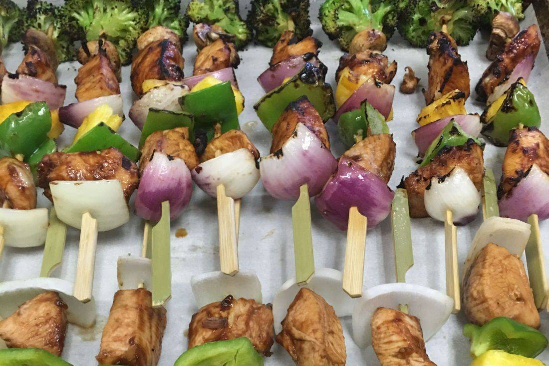 Grilled chicken skewers for graduation party catering
