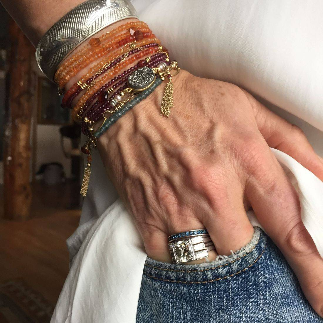 Three layered Gemstone wrap bracelets worn together.....very upscale tribal