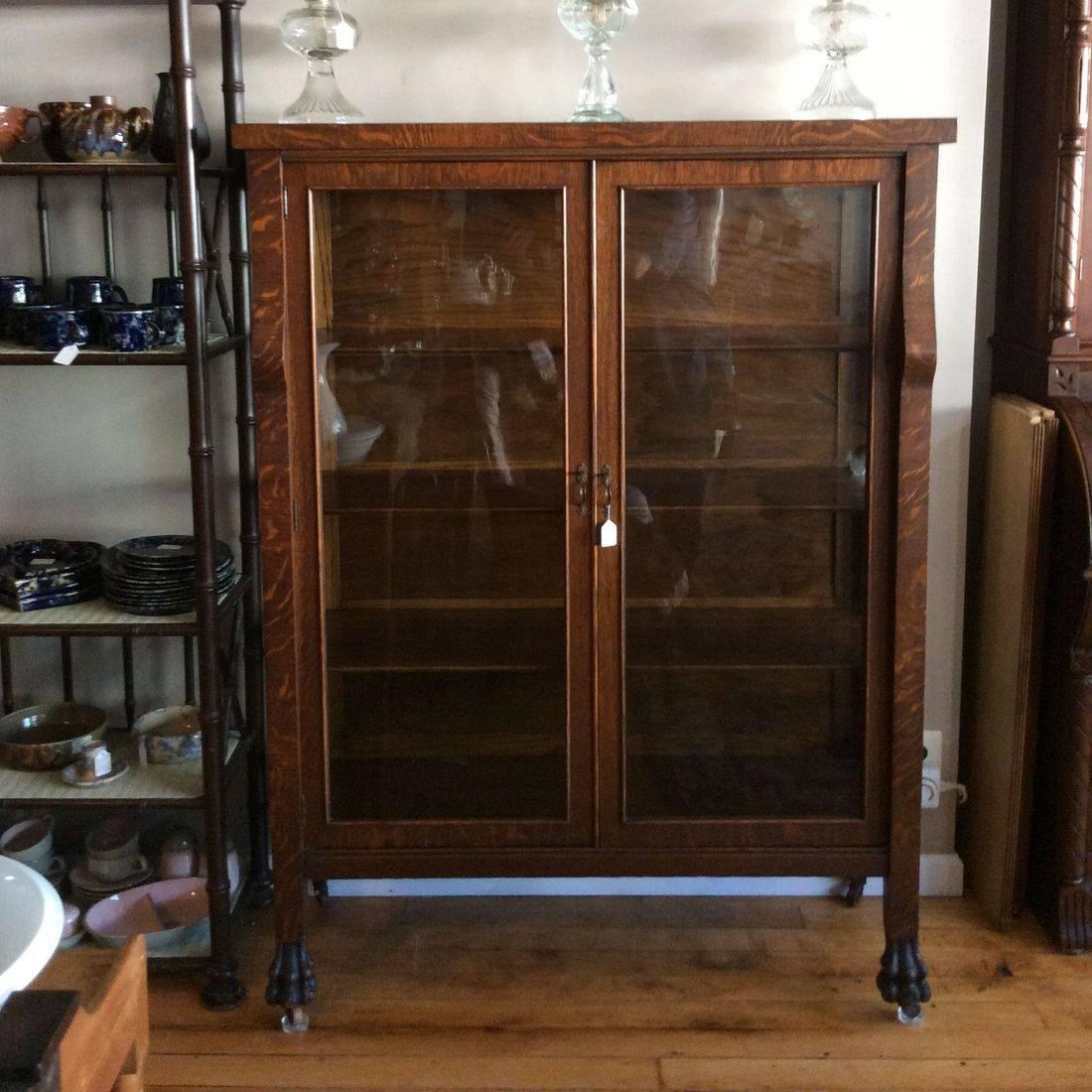 "C. 1910/1920's Oak 4-Shelf China Cabinet w/Claw Feet - 44-1/4""W x 16-1/2""D x 59""H.  $325.00"