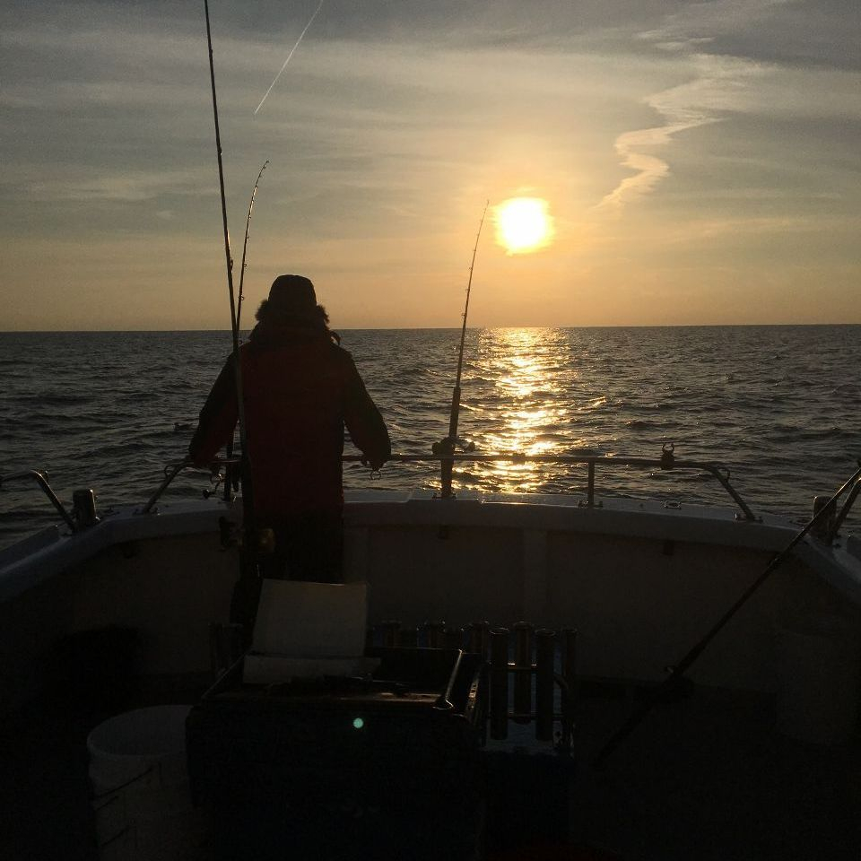 Fisherman fishing at sunset