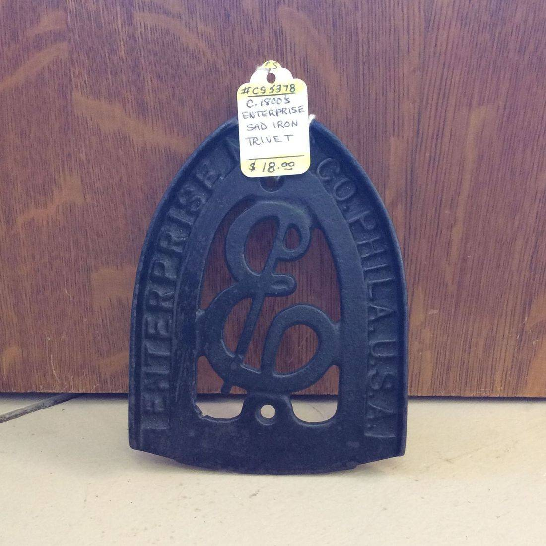 C. 1800's Enterprise Sad Iron Trivet   $18.00