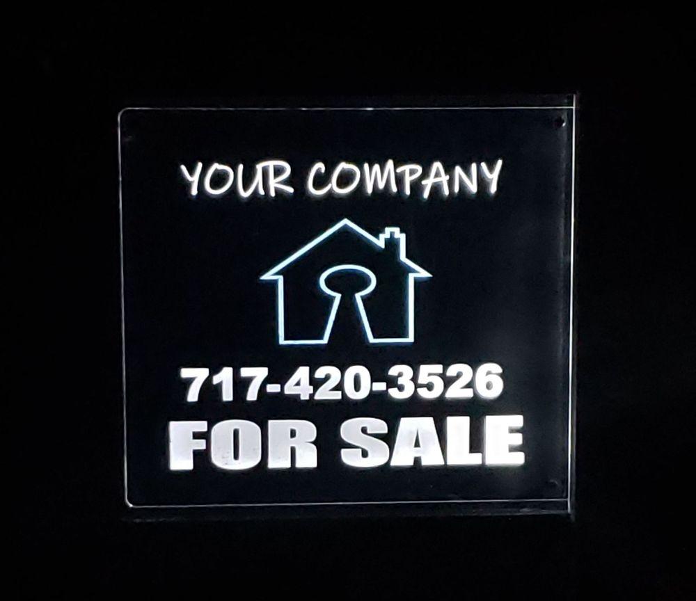 illuminated real estate sign